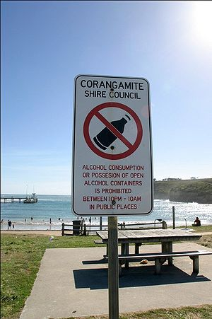 sign informing citizens of illegal drinking ho...